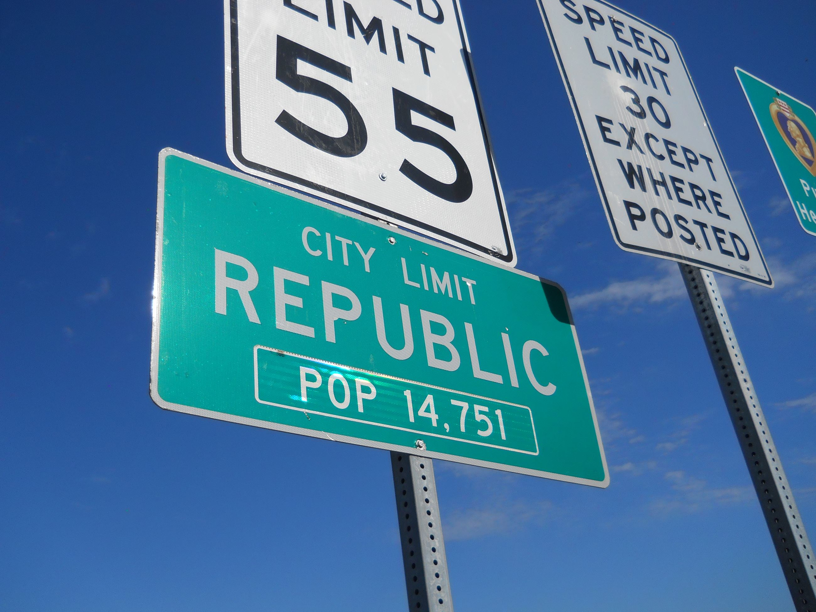 Signs marking the City Limits of Republic.