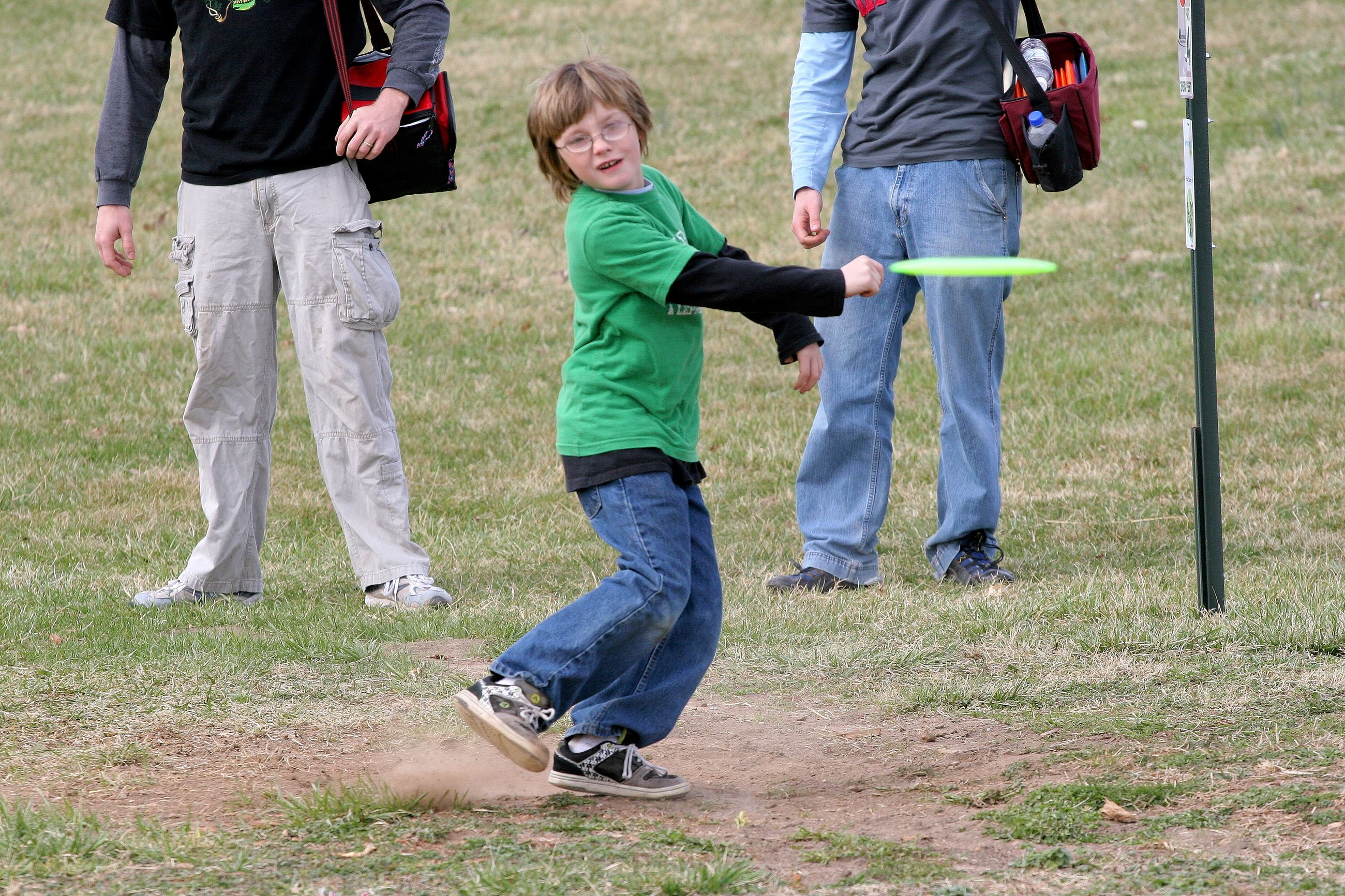 Child playing disc golf