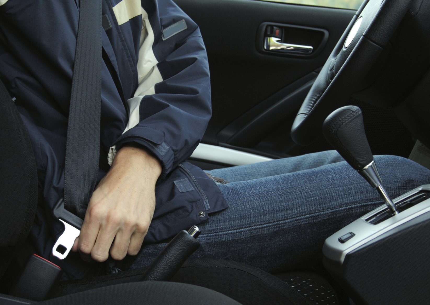 Person Buckling Seat Belt